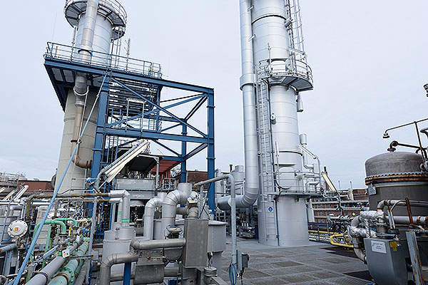 The latest expansion project installed a new reaction system and a new 46m-high distillation column.