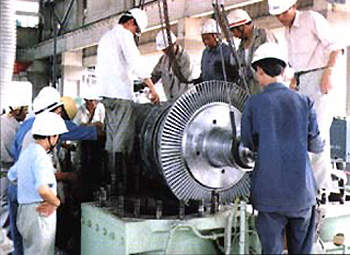 A compressor unit being serviced by Yanshan Petrochemical staff.