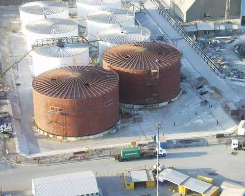 View of the storage tanks for the merchant grade phosphoric acid (MGA) for export showing the two new large tanks nearing completion. Each of the new tanks will have a capacity of 10,000t of MGA.